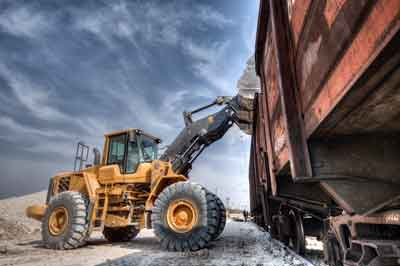 Loader putting load in train